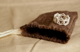 3D printed plastic ring prototype, hand-sewn linen pouch