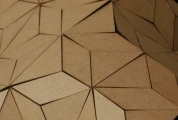 laser cut chipboard adhered to fabric